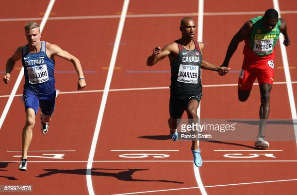 Karl Robert Saluri of Estonia Damian Warner of Canada and Lindon Victor of Grenada compete in the Men's Decathlon 100 metres during day eight of the...