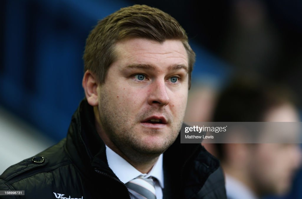 Karl Robinson, manager of Milton Keynes Dons looks on during the FA Cup with Budweiser Third Round match between Sheffield Wednesday and Milton Keynes Dons at Hillsborough Stadium on January 5, 2013 in Sheffield, England.