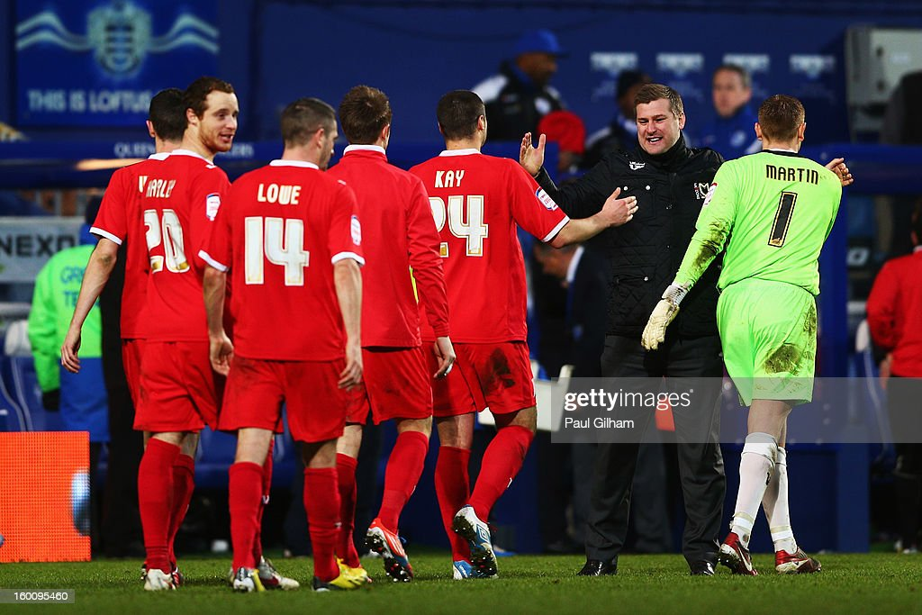 Karl Robinson the Milton Keynes Dons manager celebrates with his players following their victory during the FA Cup with Budweiser Fourth Round match between Queens Park Rangers and Milton Keynes Dons at Loftus Road on January 26, 2013 in London, England.