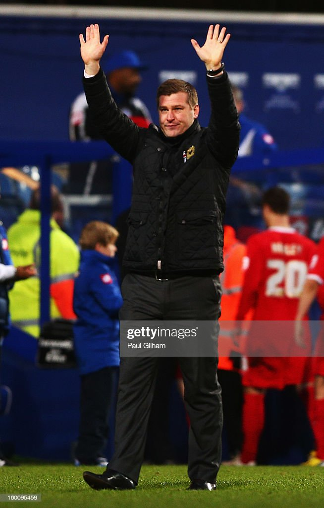 Karl Robinson the Milton Keynes Dons manager salutes his sides fans following their victory during the FA Cup with Budweiser Fourth Round match between Queens Park Rangers and Milton Keynes Dons at Loftus Road on January 26, 2013 in London, England.