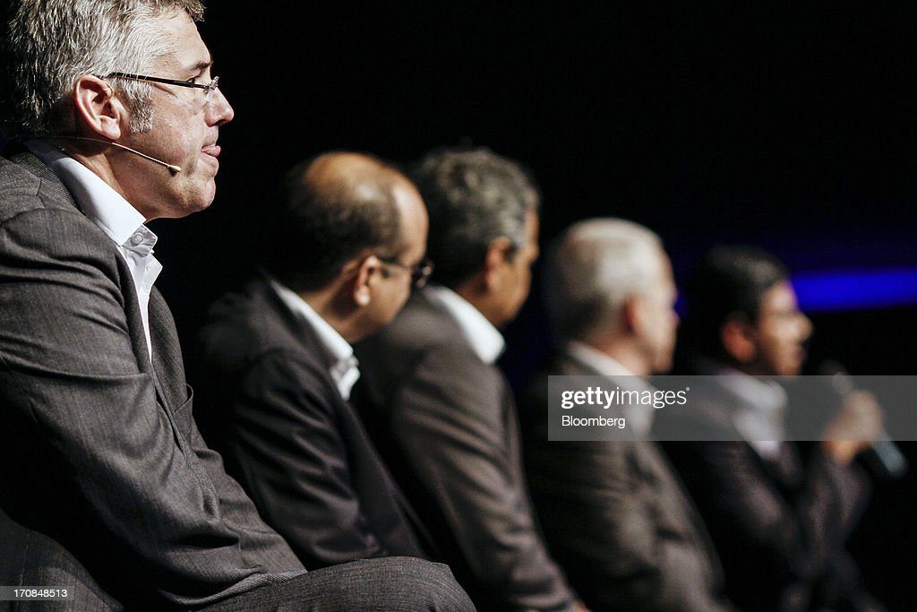 Karl Slym, managing director of Tata Motors Ltd., left, listens during a Tata Motors media event in Pune, India, on Wednesday, June 19, 2013. Tata Motors announced the introduction of 8 new models today. Photographer: Dhiraj Singh/Bloomberg via Getty Images