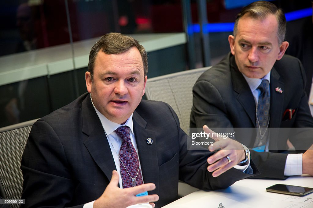 Karl Smith, executive vice president and chief financial officer of Fortis Inc., right, looks on while Barry Perry, president and chief executive officer of Fortis, speaks during an interview in New York, U.S., on Thursday, Feb. 11, 2016. Fortis Inc., Canadas largest utility owner, is confident it can find an investor to take a stake in ITC Holdings Corp. as part of its $6.9 billion takeover of the U.S. transmission line operator. Photographer: Michael Nagle/Bloomberg via Getty Images