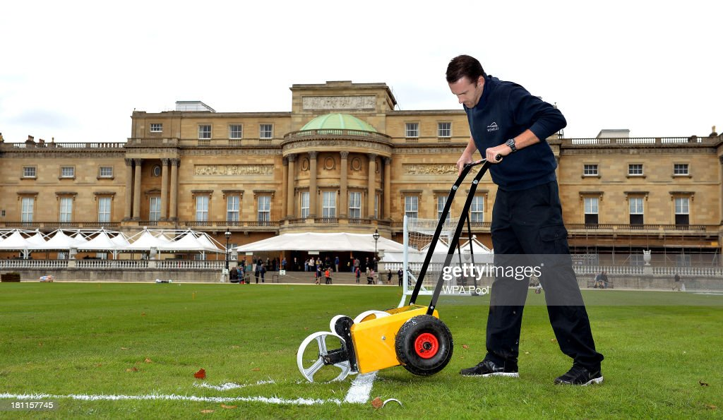 Karl Standley, a groundsman at Wembley Stadium, marks out the the lines of a football pitch in the gardens of Buckingham Palace on September 19, 2013 in London, England. The Palace is to host its first official football match as part of the Football Association's 150th anniversary celebrations. Prince William, Duke of Cambridge, president of the FA, has helped arrange the game between two of England's oldest amateur clubs, Civil Service FC and Polytechnic FC, both based in Chiswick. They will play at the palace on October 7th.