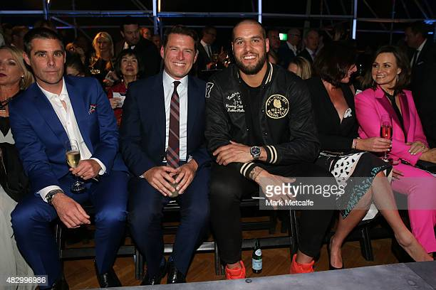 Karl Stefanovic and Lance Franklin sit front row during the David Jones Spring/Summer 2015 Fashion Launch at David Jones Elizabeth Street Store on...