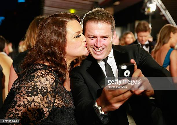 Karl Stefanovic is kissed by Chrissie Swan as they pose for a selfie at the 57th Annual Logie Awards at Crown Palladium on May 3 2015 in Melbourne...