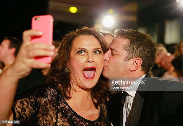 Karl Stefanovic kisses Chrissie Swan as she takes a selfie at the 57th Annual Logie Awards at Crown Palladium on May 3 2015 in Melbourne Australia
