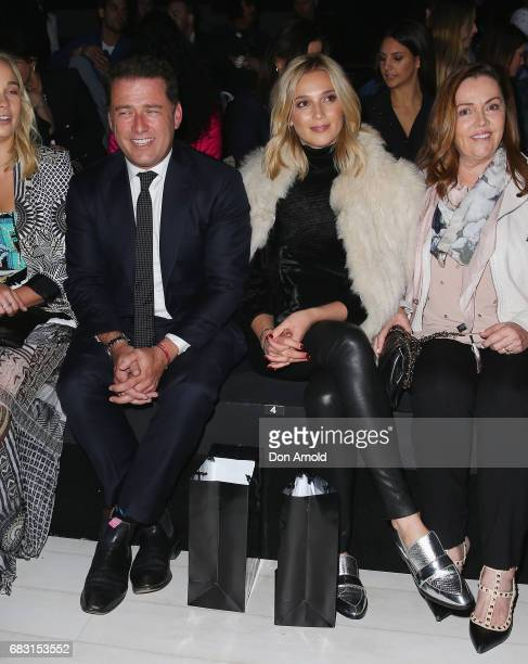 Karl Stefanovic sits front row beside his girlfriend Jasmine Yarbrough prior to the Justin Cassin show at MercedesBenz Fashion Week Resort 18...