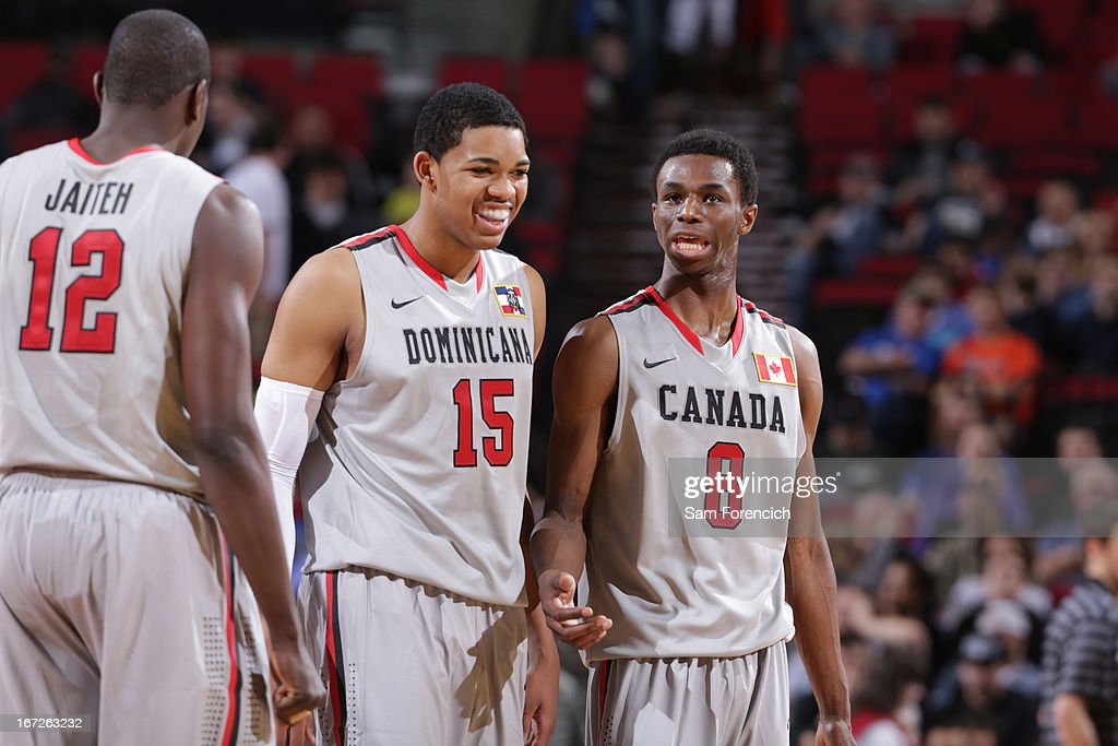 Karl Towns Jr. #15 and Andrew Wiggins #8 of the World Select Team share a word during the 2013 Nike Hoop Summit game against the USA Junior Select Team on April 20, 2013 at the Rose Garden Arena in Portland, Oregon.
