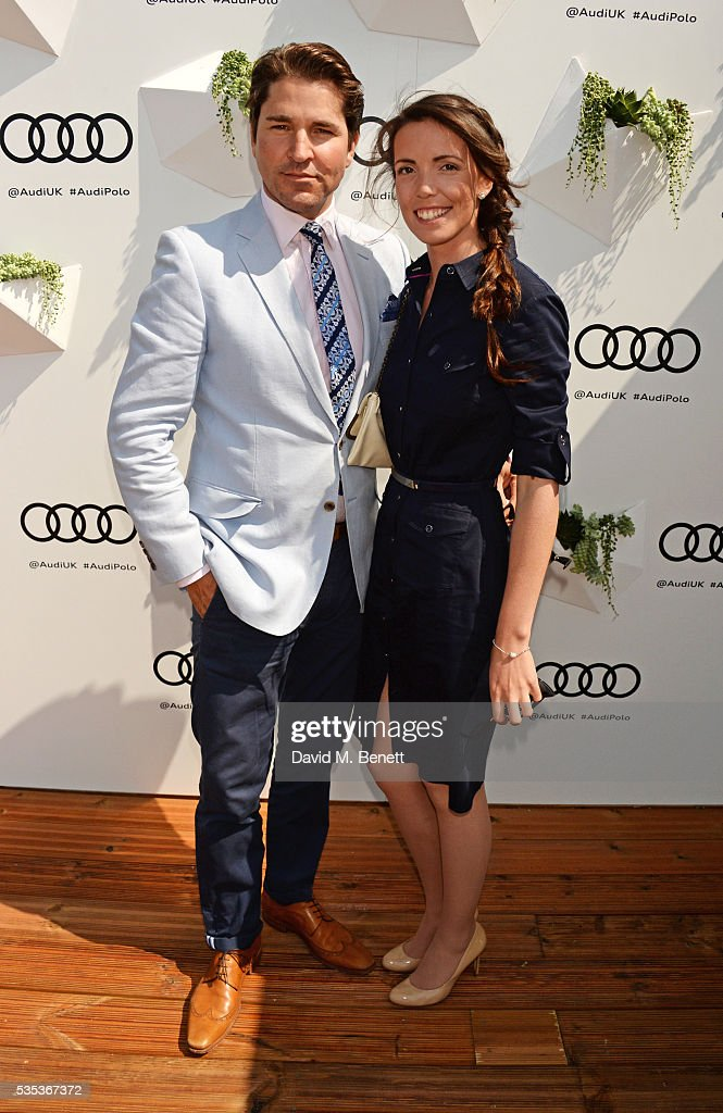 Karl Ude-Martinez (L) and Kelly Baddeley attend day two of the Audi Polo Challenge at Coworth Park on May 29, 2016 in London, England.