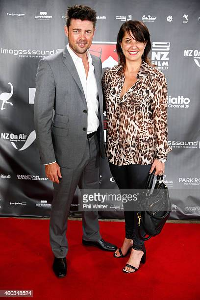 Karl Urban and Imogen Johnson pose on the red carpet as they arrive for the Rialto Channel New Zealand Film Awards on December 12 2014 in Auckland...