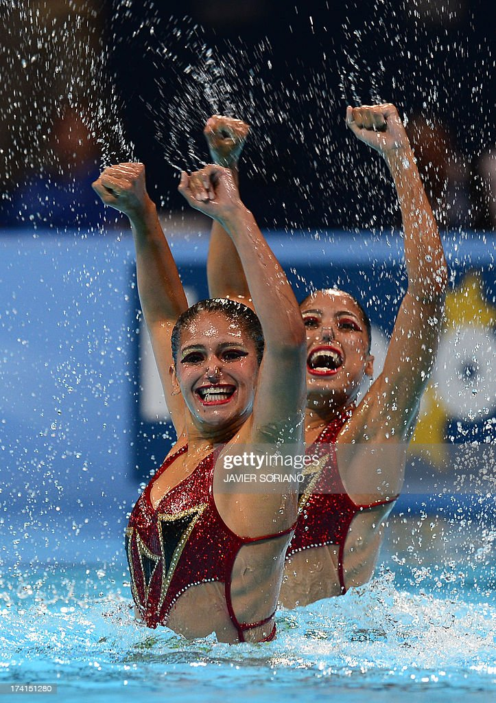 Karla Loiza and Venezuela's Albany Avila compete in the duet technique preliminary round during the synchronised swimming competition in the FINA World Championships at the Palau Sant Jordi in Barcelona, on July 21, 2013.
