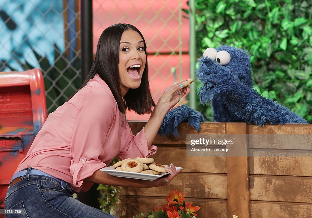 Karla Martinez and Cookie Monster are seen during Sesame Street's visit of Univision's 'Despierta America' at Univision Headquarters on July 12, 2013 in Miami, Florida.