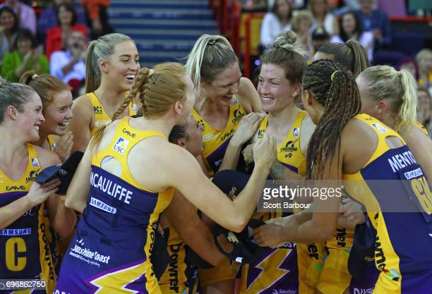 Karla Mostert of the Lightning celebrates with her teammates after being presented with the Grand Final MVP award after winning the Super Netball...