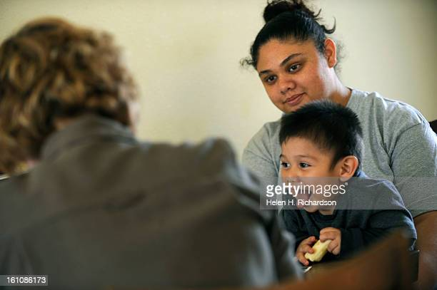 Karla Work left sits and chats with mother Diana Bereda and her young 21 month old son Marcos Manuel at a recent visit to the Bereda household in...