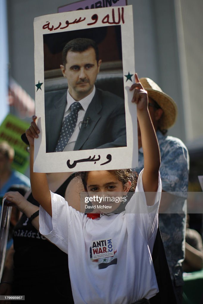 Karla Youssef, 8, holds a photo of Syrian President Bashar Hafez al-Assad at a rally to urge Congress to vote against a limited military strike against the Syrian military in response to allegations that Assad has used sarin gas to kill civilians on September 7, 2013 in Los Angeles, California. The Obama administration claims to have clear evidence that the Syrian military broke international law by killing nearly 1,500 Syrian civilians, including at least 426 children, in a chemical weapons attack on August 21, and is seeking the support of Congress for a missile strikes to prevent future chemical weapons attacks by the regime and other nations.