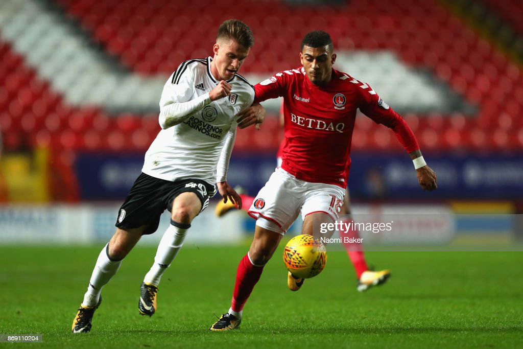 Karlan Ahearne-Grant of Charlton and Mattias Kait of Fulham battle for posession during the Checkatrade Trophy match between Charlton and Fulham at The Valley on November 1, 2017 in London, England.