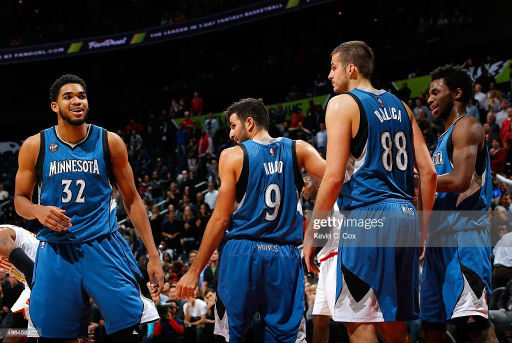 Karl-Anthony Towns #32 and <a gi-track='captionPersonalityLinkClicked' href=/galleries/search?phrase=Andrew+Wiggins&family=editorial&specificpeople=7720937 ng-click='$event.stopPropagation()'>Andrew Wiggins</a> #22 of the Minnesota Timberwolves react after <a gi-track='captionPersonalityLinkClicked' href=/galleries/search?phrase=Ricky+Rubio&family=editorial&specificpeople=4028920 ng-click='$event.stopPropagation()'>Ricky Rubio</a> #9 draws a charge from Kent Bazemore #24 of the Atlanta Hawks at Philips Arena on November 9, 2015 in Atlanta, Georgia. NOTE TO USER User expressly acknowledges and agrees that, by downloading and or using this photograph, user is consenting to the terms and conditions of the Getty Images License Agreement.