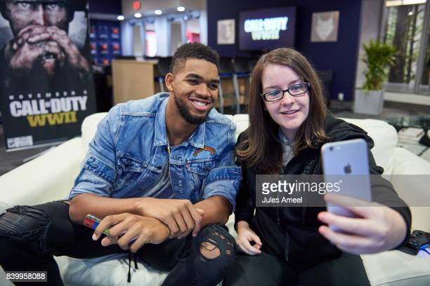KarlAnthony Towns and Ashley Glassel live stream 'Call of Duty WWII' beta on August 27 2017 in Minneapolis Minnesota