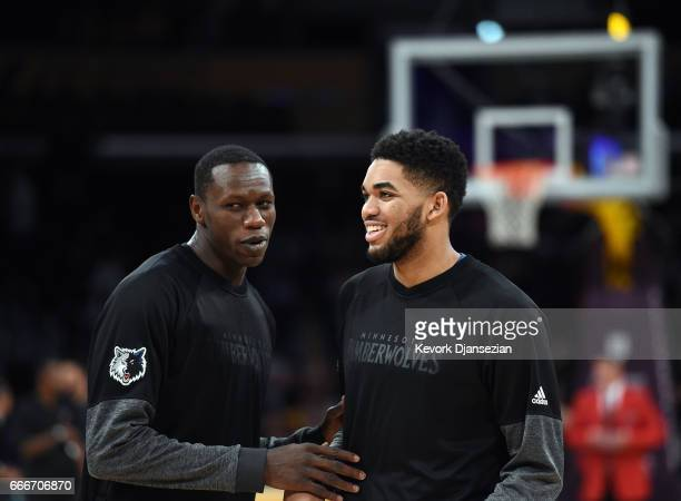 KarlAnthony Towns and Gorgui Dieng of the Minnesota Timberwolves during warm up before the start of the basketball game against Los Angeles Lakers at...
