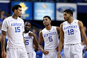 KarlAnthony Towns Andrew Harrison Dominique Hawkins and Willie CauleyStein of the Kentucky Wildcats look on against the Vanderbilt Commodores during...