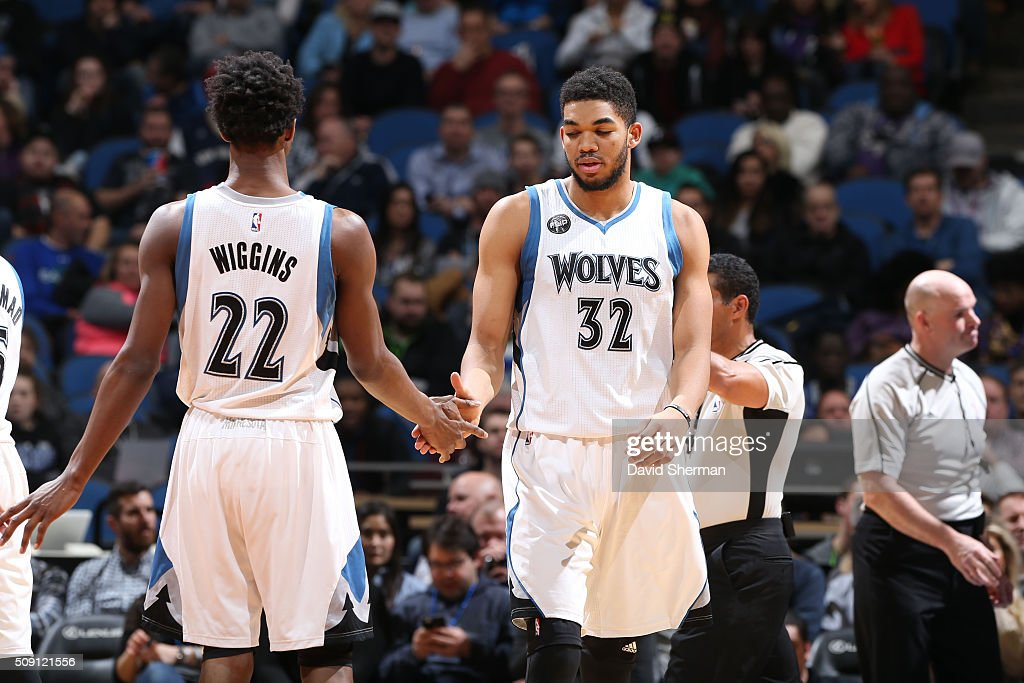 Karl-Anthony Towns #32 high fives teammate <a gi-track='captionPersonalityLinkClicked' href=/galleries/search?phrase=Andrew+Wiggins&family=editorial&specificpeople=7720937 ng-click='$event.stopPropagation()'>Andrew Wiggins</a> #22 of the Minnesota Timberwolves during the game against the New Orleans Pelicans on February 8, 2016 at Target Center in Minneapolis, Minnesota.