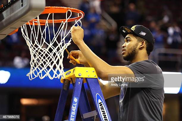 KarlAnthony Towns of the Kentucky Wildcats cuts down the net after defeating the Notre Dame Fighting Irish during the Midwest Regional Final of the...