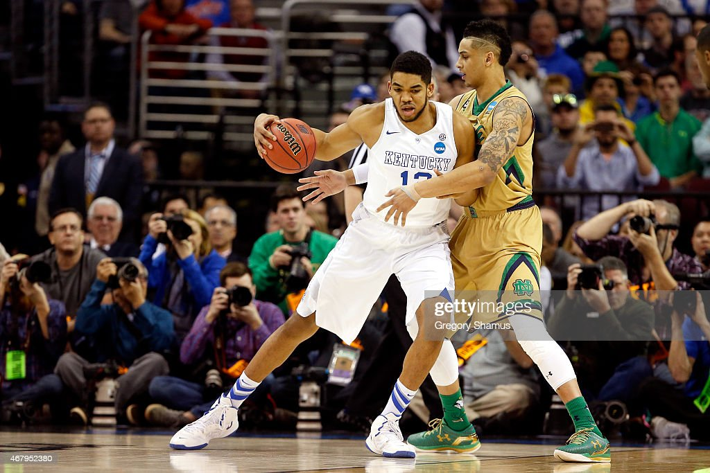 KarlAnthony Towns of the Kentucky Wildcats handles the ball against Zach Auguste of the Notre Dame Fighting Irish in the first half during the...