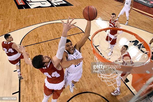 KarlAnthony Towns of the Kentucky Wildcats handles the ball against Frank Kaminsky of the Wisconsin Badgers in the first half during the NCAA Men's...
