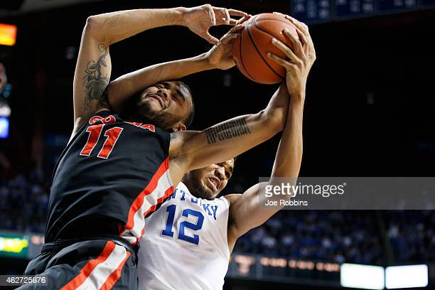 KarlAnthony Towns of the Kentucky Wildcats rebounds against Cameron Forte of the Georgia Bulldogs during the game at Rupp Arena on February 3 2015 in...