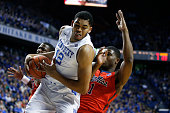 KarlAnthony Towns of the Kentucky Wildcats rebounds against Martavious Newby of the Mississippi Rebels in the first half of the game at Rupp Arena on...