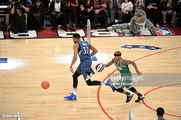 KarlAnthony Towns of the Minnesota Timberwolves and Isaiah Thomas of the Boston Celtics dribble the ball during the Taco Bell Skills Challenge as...