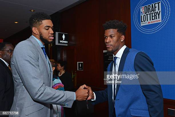 KarlAnthony Towns of the Minnesota Timberwolves and Jimmy Butler of the Chicago Bulls shake hands during the 2016 NBA Draft Lottery at the New York...