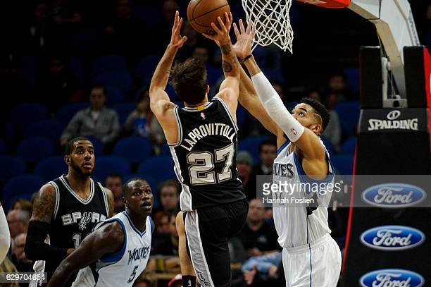 KarlAnthony Towns of the Minnesota Timberwolves defends against a shot by Nicolas Laprovittola of the San Antonio Spurs during the game on December 6...