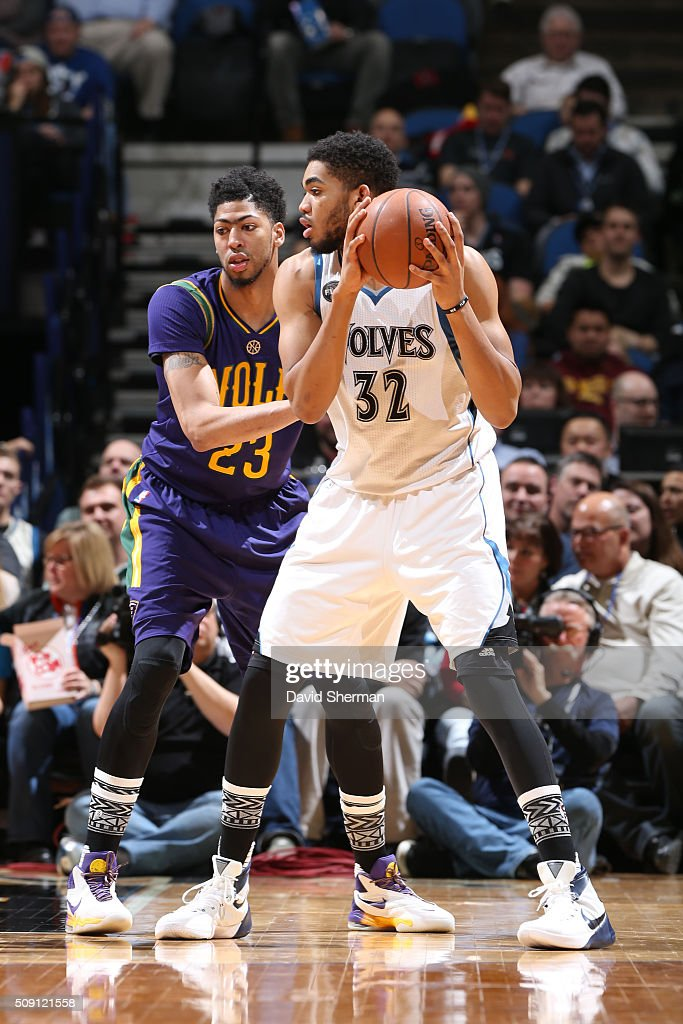 Karl-Anthony Towns #32 of the Minnesota Timberwolves defends the ball against <a gi-track='captionPersonalityLinkClicked' href=/galleries/search?phrase=Anthony+Davis+-+Basketball+Player&family=editorial&specificpeople=9539354 ng-click='$event.stopPropagation()'>Anthony Davis</a> #23 of the New Orleans Pelicans during the game on February 8, 2016 at Target Center in Minneapolis, Minnesota.