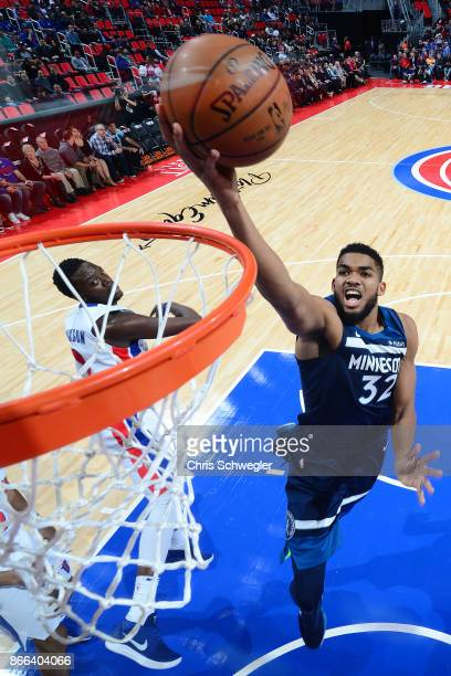 KarlAnthony Towns of the Minnesota Timberwolves drives to the basket against the Detroit Pistons on October 25 2017 at Little Caesars Arena in...