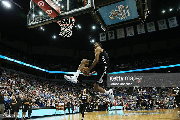 KarlAnthony Towns of the Minnesota Timberwolves dunks before the scrimmage on July 8 2015 at Target Center in Minneapolis Minnesota NOTE TO USER User...