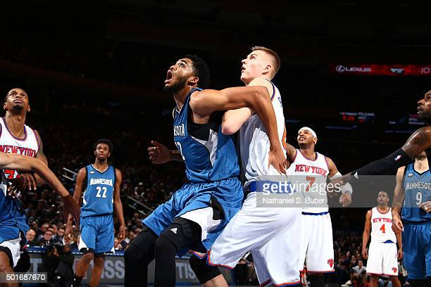 KarlAnthony Towns of the Minnesota Timberwolves fights for the position against Kristaps Porzingis of the New York Knicks during the game on December...