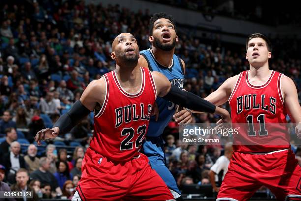 KarlAnthony Towns of the Minnesota Timberwolves fights for the position against Taj Gibson and Doug McDermott of the Chicago Bulls on February 12...
