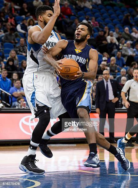 KarlAnthony Towns of the Minnesota Timberwolves guards against Andrew Harrison of the Memphis Grizzlies during the preseason game on October 19 2016...