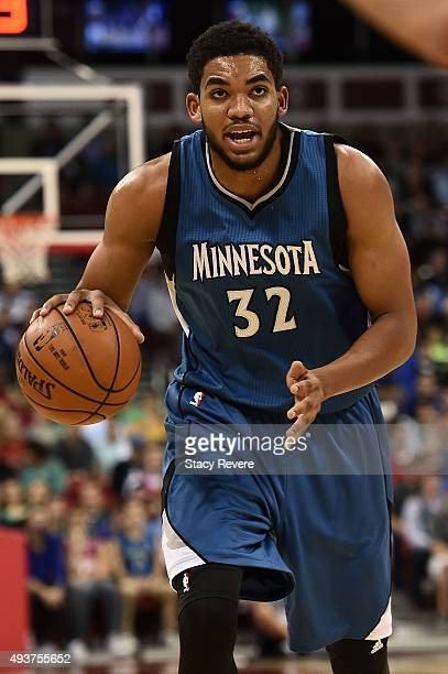 KarlAnthony Towns of the Minnesota Timberwolves handles the ball during a preseason game against the Milwaukee Bucks at the Kohl Center on October 20...
