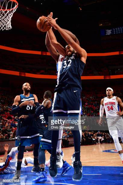 KarlAnthony Towns of the Minnesota Timberwolves handles the ball against the Detroit Pistons on October 25 2017 at Little Caesars Arena in Detroit...