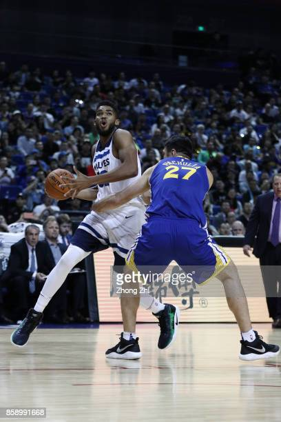 KarlAnthony Towns of the Minnesota Timberwolves in action against Zaza Pachulia of the Golden State Warriors during the game between the Minnesota...