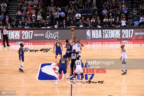KarlAnthony Towns of the Minnesota Timberwolves jumps the opening tip against Zaza Pachulia of the Golden State Warriors as part of the 2017 Global...