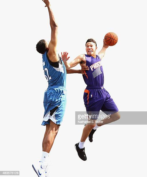 KarlAnthony Towns of the Minnesota Timberwolves poses for a photo with Devin Booker of the Phoenix Suns during the 2015 NBA Rookie Shoot on August 8...