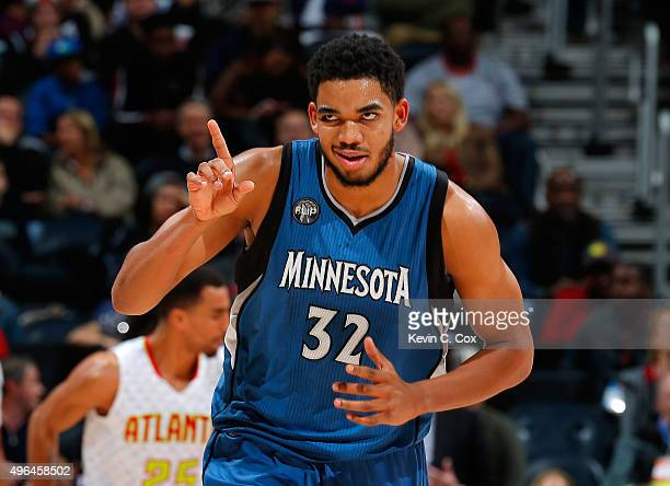 KarlAnthony Towns of the Minnesota Timberwolves reacts after hitting a basket against the Atlanta Hawks at Philips Arena on November 9 2015 in...