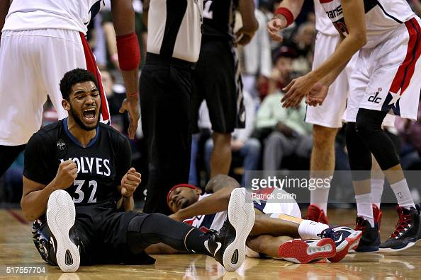 KarlAnthony Towns of the Minnesota Timberwolves reacts in the first overtime against the Washington Wizards at Verizon Center on March 25 2016 in...