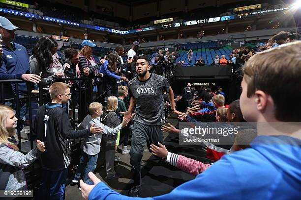 KarlAnthony Towns of the Minnesota Timberwolves runs out of the tunnel before an NBA preseason game against the Memphis Grizzlies on October 19 2016...