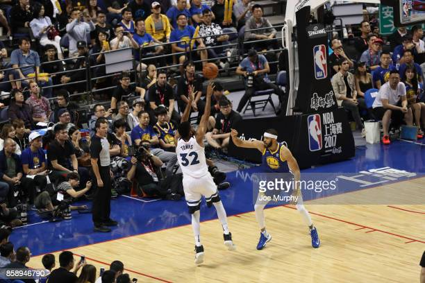 KarlAnthony Towns of the Minnesota Timberwolves shoots against JaVale McGee of the Golden State Warriors as part of the 2017 Global Games China on...