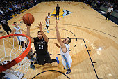 KarlAnthony Towns of the Minnesota Timberwolves shoots the ball against the Denver Nuggetson October 30 2015 at the Pepsi Center in Denver Colorado...