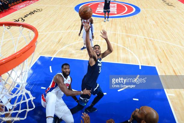 KarlAnthony Towns of the Minnesota Timberwolves shoots the ball against the Detroit Pistons on October 25 2017 at Little Caesars Arena in Detroit...